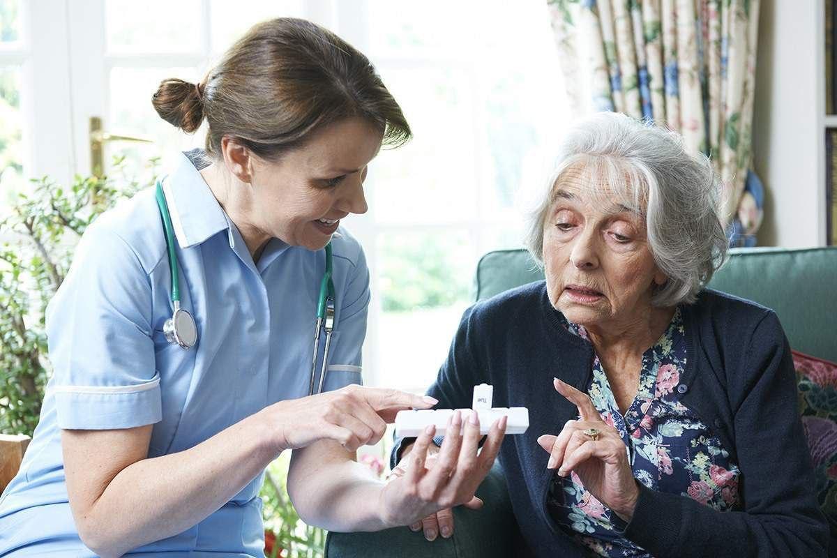 nurse-and-eldery-woman-medicine.jpg